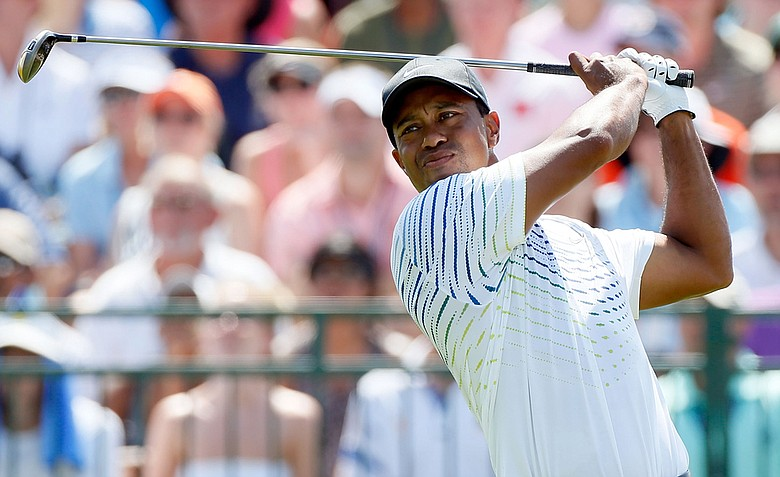 Tiger Woods hits off the first tee during Round Three of the 94th PGA Championship at the Ocean Course on August 11, 2012 in Kiawah Island, S.C.