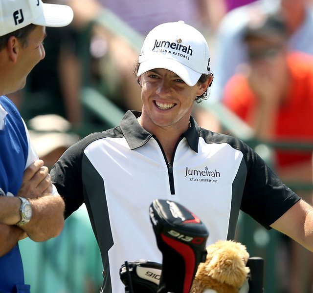 Rory McIlroy talks to his caddie J.P. Fitzgerald on the first tee during the third round of the 94th PGA Championship at the Ocean Course in Kiawah Island, S.C.