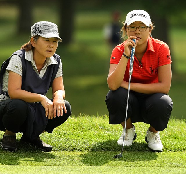 Lydia Ko, right, with her mom/caddie, Tina, at No. 16 during the finals at the 112th U. S. Women&#39;s Amateur Championship.