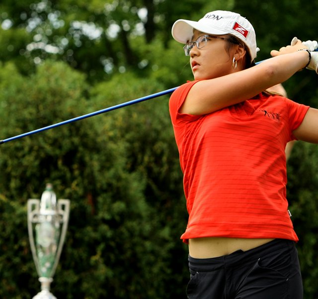 Lydia Ko of New Zealand hits her tee shot to begin the second round of play during the finals at the 112th U. S. Women&#39;s Amateur Championship.