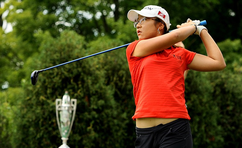 Lydia Ko of New Zealand hits her tee shot to begin the second round of play during the finals at the 112th U. S. Women's Amateur Championship.