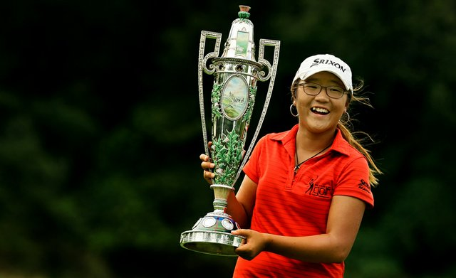 Lydia Ko poses with The Robert Cox Trophy after defeating Jaye Marie Green 3&1 during the finals at the 112th U. S. Women's Amateur Championship at The Country Club in Cleveland.