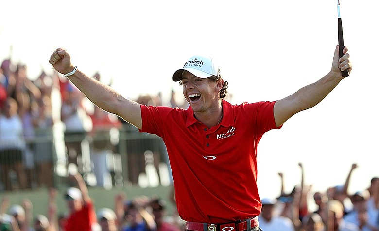 Rory McIlroy celebrates after draining a birdie putt on the 18th green to win the 94th PGA Championship by eight strokes on Sunday.