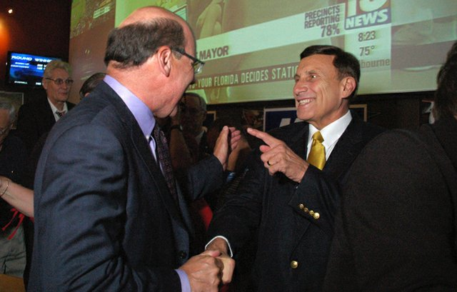 U.S. Rep. John Mica greets a supporter at his victory party Tuesday after defeating Republican opponent U.S. Rep. Sandy Adams in the primary election.