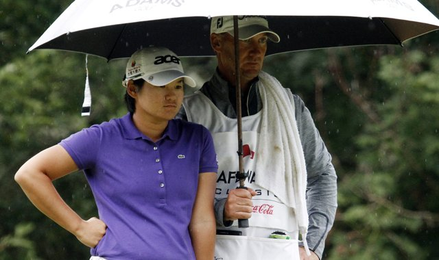 Yani Tseng stands with her caddie during the Safeway Classic.