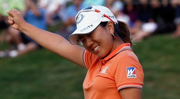 Mika Miyazato celebrates her win with a par putt on the 18th hole during the final round of the Safeway Classic at Pumpkin Ridge Golf Club.