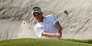 Poulter, Donald look for strong finish in Dubai
