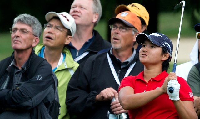Yani Tseng watches as her second shot hits a tree and lands in the rough on the first hole during the first round of the LPGA Tour&#39;s Canadian Women&#39;s Open.