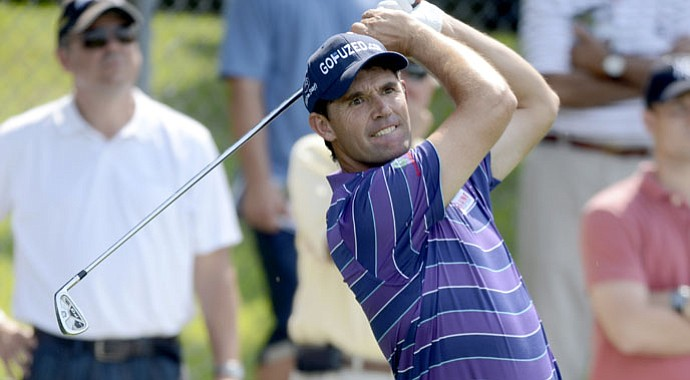 Padraig Harrington fired a 7-under 64 to tie the course record at Bethpage Black on Thursday.
