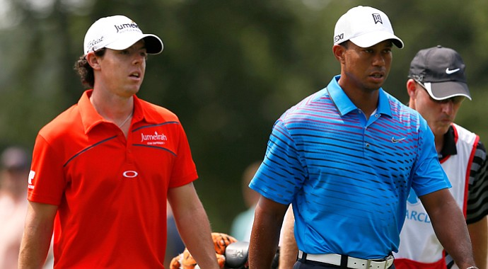Tiger Woods and Rory McIlroy walk up the fairway on the second hole during the second round of The Barclays.