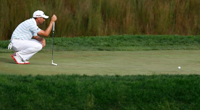 Sergio Garcia lines up a putt on the 16th green during the third round of The Barclays at the Black Course at Bethpage State Park.