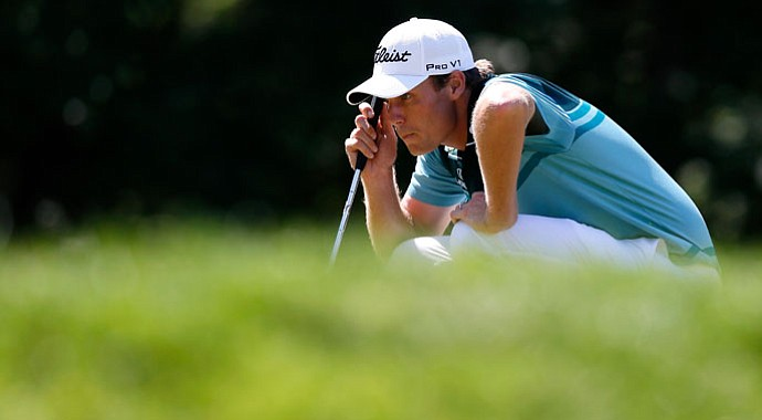 Nick Watney lines up a putt on the third hole green during the final round of The Barclays.