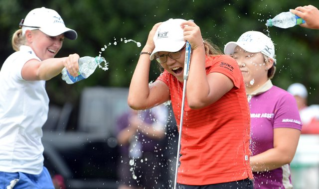 Lydia Ko is doused with water by Stacy Lewis, Jiyai Shin in celebration of her three-shot victory at the Canadian Women&#39;s Open.