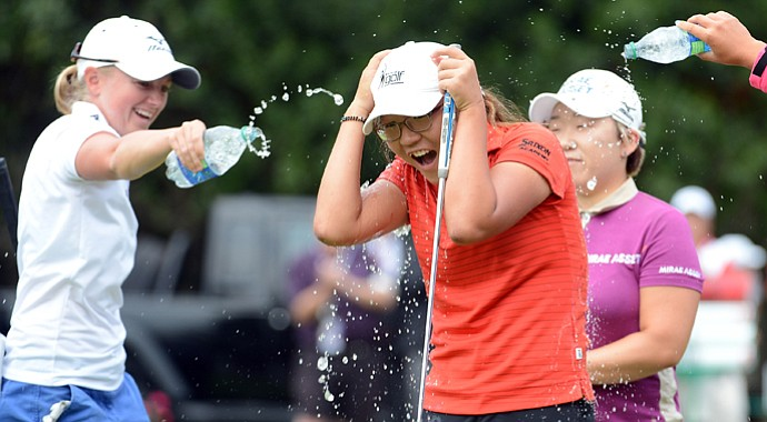 Lydia Ko is doused with water by Stacy Lewis, Jiyai Shin in celebration of her three-shot victory at the Canadian Women's Open.