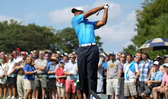 Tiger Woods tees off on the third hole during the second round of the Deutsche Bank Championship.