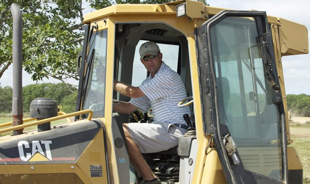 Unlike many architects, Gil Hanse likes to work on the bulldozer shaping greens. 