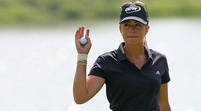 Paula Creamer waves to the crowd after finishing her round on the 18th hole during the third round of the Kingsmill Championship.