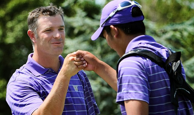Cheng-Tsung Pan (right) gets a fist-bump from Washington head coach Matt Thurmond. Pan led the Huskies to a home victory on Sept. 18.