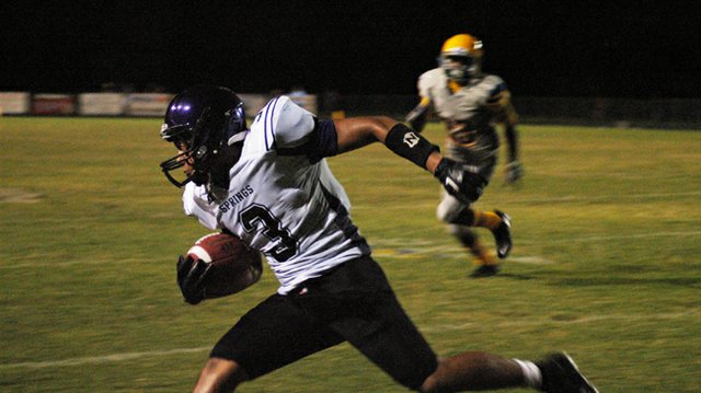 Winter Springs wide receiver Alex Lindores races past Lyman's secondary defense during the Bears' 17-6 loss to the Greyhounds Sept. 14.