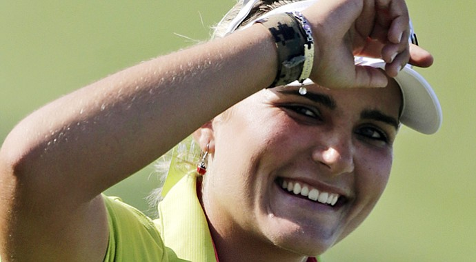 Lexi Thompson smiles after shooting 9-under 63 during the first round of the Navistar LPGA Classic.