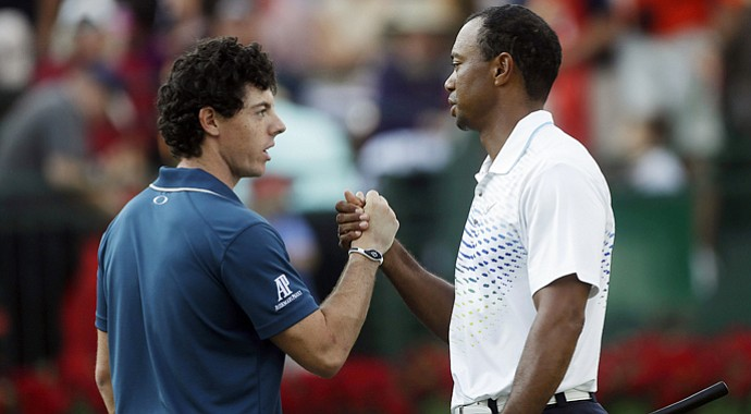 Rory McIlroy and Tiger Woods shake hands after the first round of the Tour Championship.