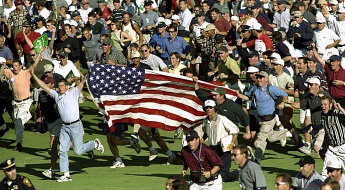 The U.S. fans celebrate during the 33rd Ryder Cup match played at the Brookline CC in Boston.