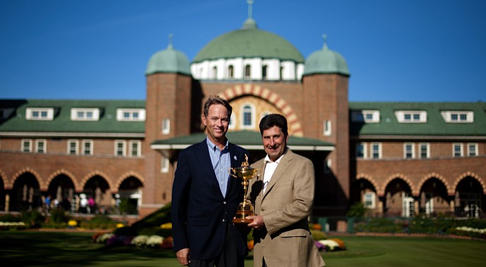 U.S. captain Davis Love III, left, poses with European captain Jose Maria Olazabal as they hold the Ryder Cup in front of the clubhouse at Medinah Country Golf Club.