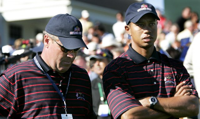 U.S. captain Hal Sutton, left stands with Tiger Woods after the Europeans beat the Americans and retained the Ryder Cup at the 35th Ryder Cup at Oakland Hills Country Club in Bloomfield Township, Mich., on Sunday, Sept. 19, 2004.