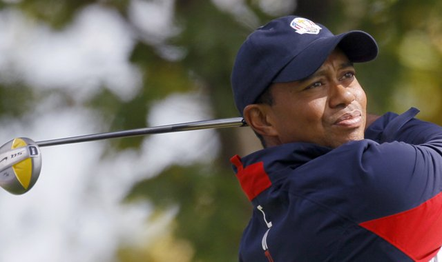 USA&#39;s Tiger Woods hits a drive during a practice round at the Ryder Cup Thursday, Sept. 27, 2012, at the Medinah Country Club in Medinah, Ill.