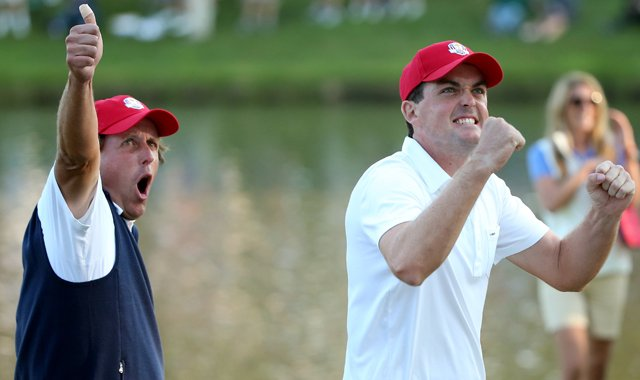 Phil Mickelson and Keegan Bradley of the USA celebrate on the 17th green after winning their four-ball match Friday at the Ryder Cup.