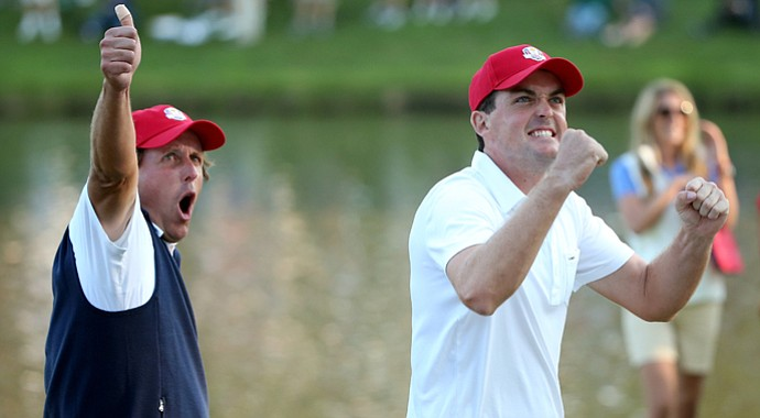 Phil Mickelson and Keegan Bradley of the USA celebrate on the 17th green after winning their Friday four-ball match during the 2012 Ryder Cup.