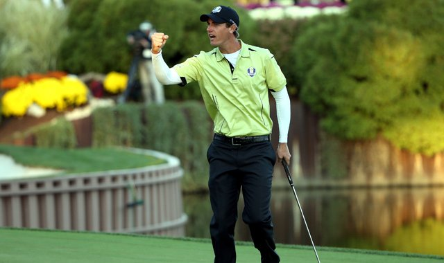 Nicolas Colsaerts of Europe celebrates a birdie putt on the 17th green during the afternoon four-ball matches.