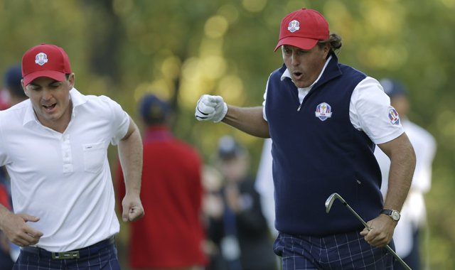 USA&#39;s Phil Mickelson, right, and Keegan Bradley react to Mickelson&#39;s tee shot on the 17th hole during a four-ball match at the Ryder Cup PGA golf tournament Friday, Sept. 28, 2012, at the Medinah Country Club in Medinah, Ill. 