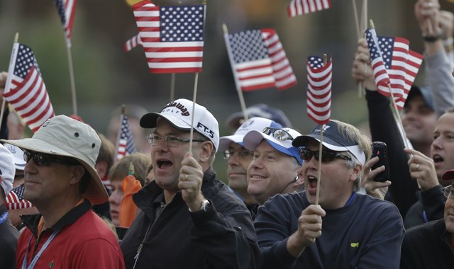 Fans cheer on the first tee during the foursomes matches at the Ryder Cup Friday, Sept. 28, 2012, at the Medinah Country Club in Medinah, Ill.