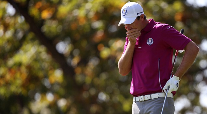 Nicolas Colsaerts of Europe reacts to hitting a ball in the water on the 17th hole during day two of the Ryder Cup.