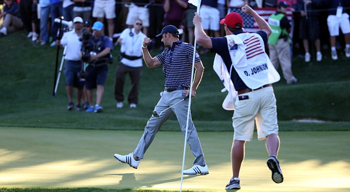 Dustin Johnson of the USA celebrates his birdie putt on the 17th green during day two of the afternoon four-ball matches at the 39th Ryder Cup at Medinah Country Club.