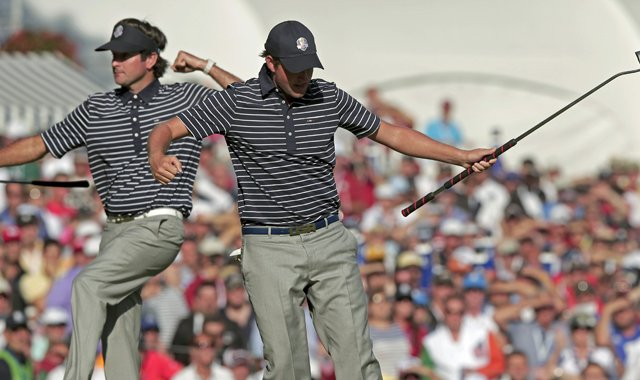 USA's Webb Simpson, right, and Bubba Watson react after Simpson made a putt to with the 13th hole during a four-ball match at the Ryder Cup Saturday, Sept. 29, 2012, at the Medinah Country Club in Medinah, Ill.