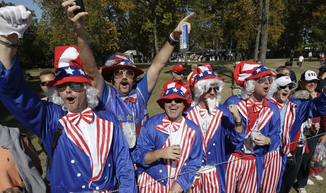 Fans cheer on the 16th hole during a foursomes match at the Ryder Cup PGA golf tournament Saturday, Sept. 29, 2012, at the Medinah Country Club in Medinah, Ill.