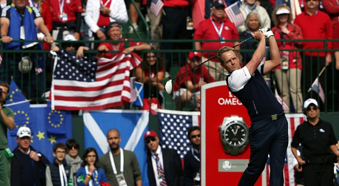 Luke Donald of Europe hits his tee shot on the first tee during his singles match against Bubba Watson.