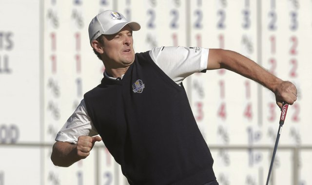 Europe&#39;s Justin Rose reacts after defeating USA&#39;s Phil Mickelson on the 18th hole during a singles match at the Ryder Cup PGA golf tournament Sunday, Sept. 30, 2012, at the Medinah Country Club in Medinah, Ill. 
