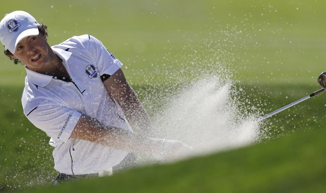 Europe&#39;s Rory McIlroy hits out of a bunker on the 14th hole during a singles match at the Ryder Cup PGA golf tournament Sunday, Sept. 30, 2012, at the Medinah Country Club in Medinah, Ill.