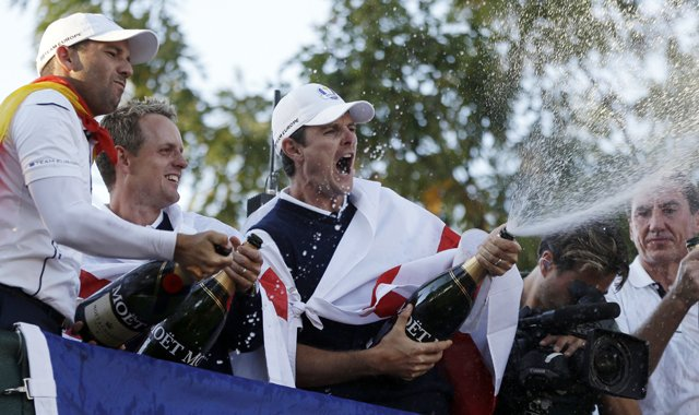 Europe's Sergio Garcia, left to right, Luke Donald and Justin Rose celebrate after winning the Ryder Cup PGA golf tournament Sunday, Sept. 30, 2012, at the Medinah Country Club in Medinah, Ill.