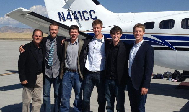 Colorado Mesa's men's golf team members in front of the private plane that brought them to Sunriver, Ore.