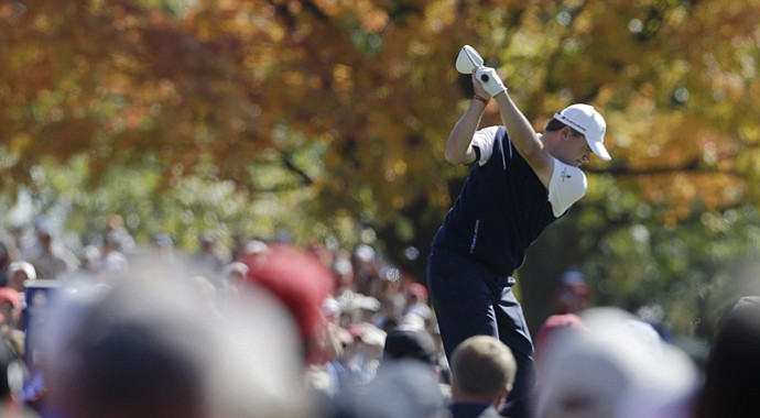 Europe's Paul Lawrie hits a drive on the ninth hole during a singles match at the Ryder Cup PGA golf tournament Sunday, Sept. 30, 2012, at the Medinah Country Club in Medinah, Ill.