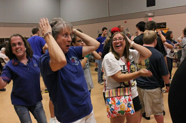 Sunshine Dance organizer Anne Marie Sargent, middle, dances with daughter Julia, left, as part of a program that lets people with special needs socialize and have fun.