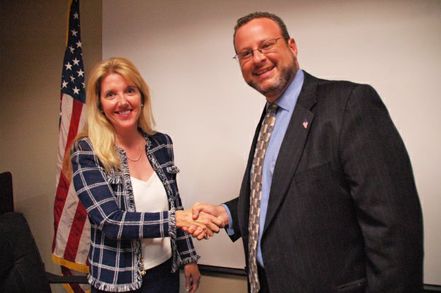 Winter Springs Commissioner Avery Smith and candidate Phil Kaprow shake hands after a candidate forum Oct. 24.