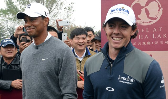 World No. 1 Rory McIlroy  and Tiger Woods pose before teeing off at the &#39;Duel at Jinsha Lake.&#39;