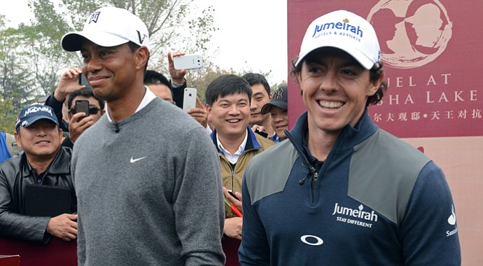 World No. 1 Rory McIlroy  and Tiger Woods pose before teeing off at the 'Duel at Jinsha Lake.'
