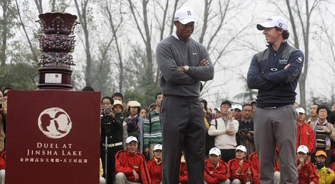 Tiger Woods and Rory McIlroy talk at the award ceremony during the Duel at Jinsha Lake Golf Club on Oct. 29, 2012.