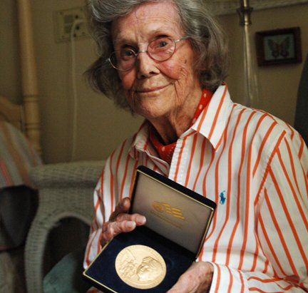 Patricia Erickson shows her Congressional Gold Medal, awarded to her for contributing to the Women Airforce Service Pilots program, volunteering her flying skills to help the World War II efforts.